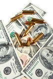 Bullets and dollars Stock Photo