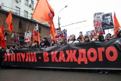 These bullets in each of us - the poster on march of memory of Nemtsov Stock Photos