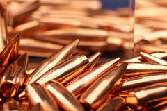 Bullets and glass cube Stock Photos