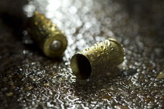 Bullets on the ground on a rainy day Royalty Free Stock Photo