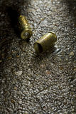 Bullets on the ground on a rainy day Stock Images