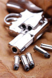 Bullets with gun Stock Images