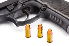 Bullets and gun Stock Photography