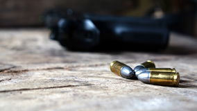 Bullets and gun Royalty Free Stock Photo