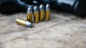 Bullets and gun Stock Photography
