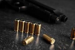 Bullets and gun Stock Image