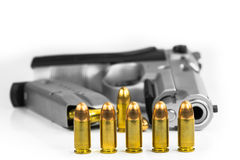 Bullets with the gun Royalty Free Stock Photo