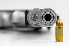 Bullets with the gun Royalty Free Stock Photography