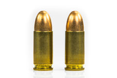 Bullets with the gun Stock Images