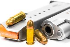 Bullets and guns on white. Firearm, aim, protection, crime, rifle shooting, handgun, police, army, target, steel, shoot, war, gun, bulle Stock Image