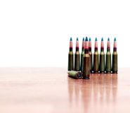 Bullets gunshot on the table standing in a row. Bullets gunshot on the table standing in a row Stock Photo