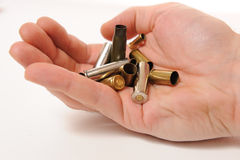 Bullets in hand Stock Images