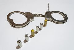 Bullets and handcuffs Royalty Free Stock Images