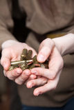 Bullets in the hands of a woman. Live ammunition. Royalty Free Stock Photos