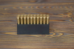Bullets for hunting on the wood Royalty Free Stock Photos