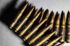 Bullets in a iron belt lined as a weapon, crime, criminal, war,. Bullets in a iron metal belt lined as a weapon, crime, criminal, war, protection, scary Royalty Free Stock Image