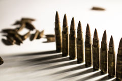 Bullets lined in a row. War, criminal, army, weapon concept Stock Photography