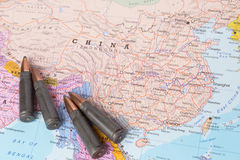 Bullets on the map of China Stock Images