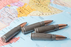 Bullets on the map of East Africa. Four bullets on the geographical map of Tanzania, Kenya, Ethiopia and Somalia in East Africa. Conceptual image for war stock photos