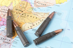 Bullets on the map of Ethiopia and Somalia. Four bullets on the geographical map of Ethiopia and Somalia. Conceptual image for war, conflict, violence stock photos