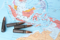 Bullets on the map of Indonesia. Four bullets on the geographical map of Indonesia. Conceptual image for war, conflict, violence stock image
