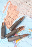 Bullets on the map of Mexico. Four bullets on the geographical map of Mexico. Conceptual image for war, conflict, violence royalty free stock photo