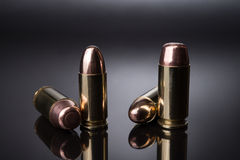 Bullets 9mm and .40. Close up shot of 9mm Parabellum FMJ and .40 S&W FMJ bullets royalty free stock images