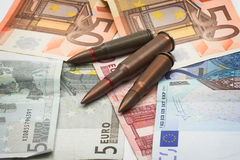 Bullets and money Royalty Free Stock Photo