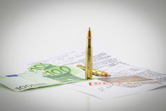 Bullets, money and documents of the investigation Stock Photo