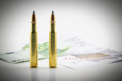 Bullets, money and documents of the investigation Royalty Free Stock Photos