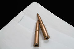 Bullets On Open Envelope Royalty Free Stock Photography