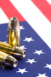 Bullets over American flag. Bullets 9mm closeup over American flag background Stock Photos