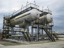 Bullets for process water in the oil field. Buffer tanks for formation water. Stock Photo