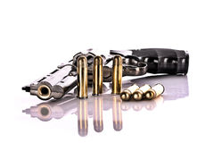 Bullets and revolver. Royalty Free Stock Image