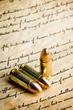 Bullets - the right to bear arms. Bullets on the bill of rights - the right to bear arms. macro with limited dof, focus on tips and bear arms section of writing Stock Images