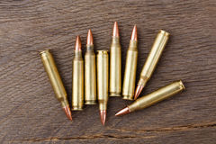 Bullets on rustic wooden background. Bullets on rustic wooden background on macro Stock Image