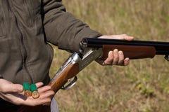 Bullets and shotgun man Royalty Free Stock Photos