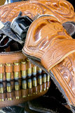 Bullets and six shooter pistol in a holster. Old wester revolver in holster Stock Photo