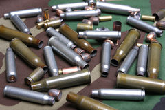 Bullets and sleeves Stock Photos