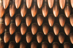 Bullets stacked up. 5.56mm rifle cartridges in stripper clips stacked up, with points toward the viewer. Closeup Royalty Free Stock Photos