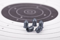 Bullets on the target. Air rifle bullets at a paper target Stock Photos