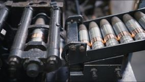 Bullets transported on automatic production line in workshop