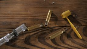 Bullets on wooden background stock video footage