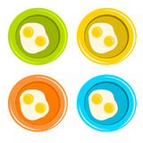 Bulleye eggs in colorful dishes Stock Photo