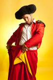 Bullfighter courage red yellow humor spanish color royalty free stock photo
