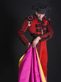 Bullfighter. Dressed in costume, on a black background Stock Photography