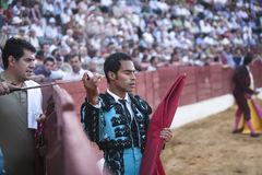 Bullfighter Luis Bolivar picking up the sword to kill the bull in the Bullring of Baeza Royalty Free Stock Photo
