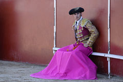 Bullfighter. Picture of a bullfighter, sitting on the sidelines, waiting for the bull Royalty Free Stock Photo