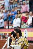 Bullfighter praying with his montera Royalty Free Stock Photo