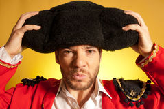 Bullfighter putting on big montera hat humor. Spanish colors stock image